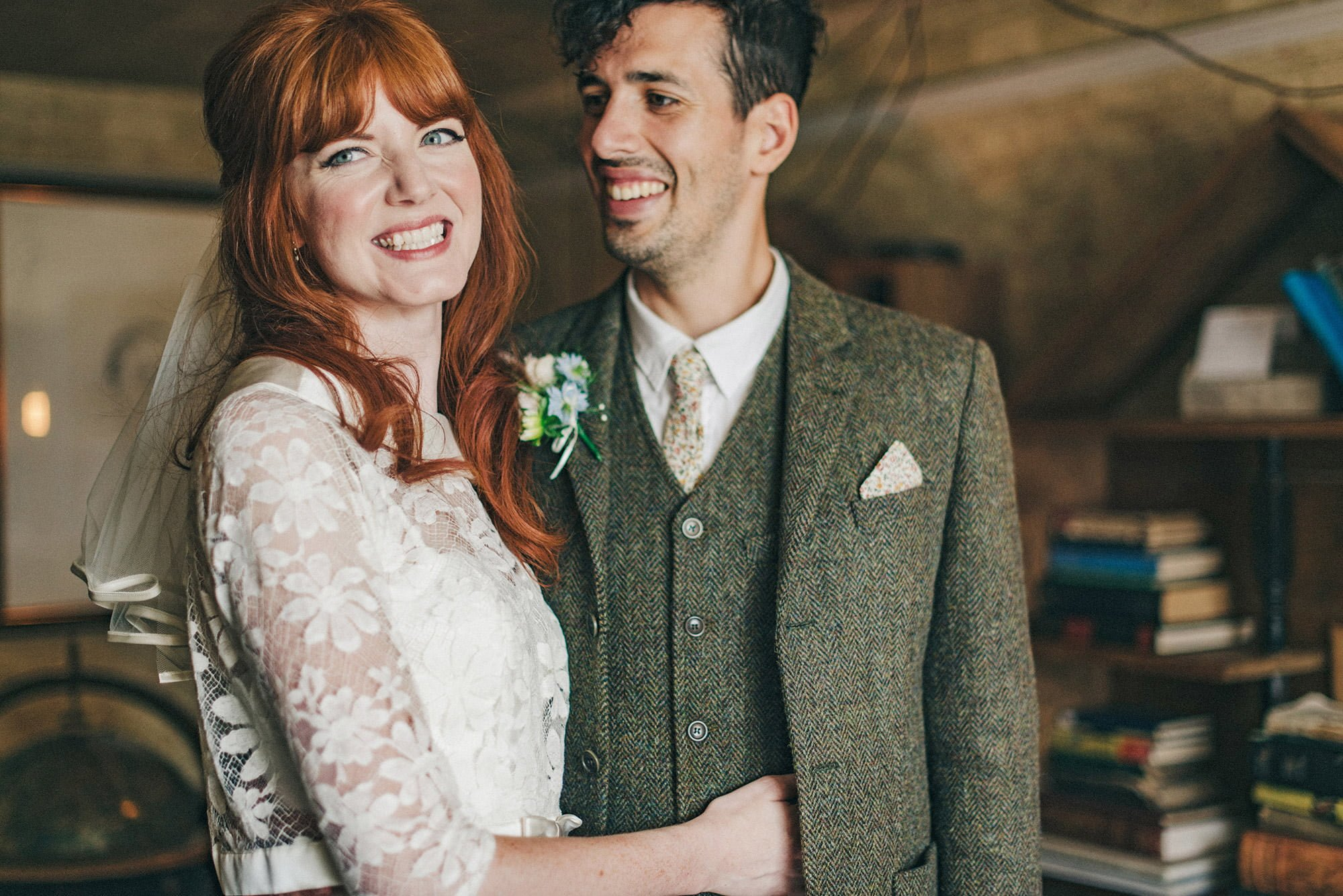 red haired bride and groom wearing tweed
