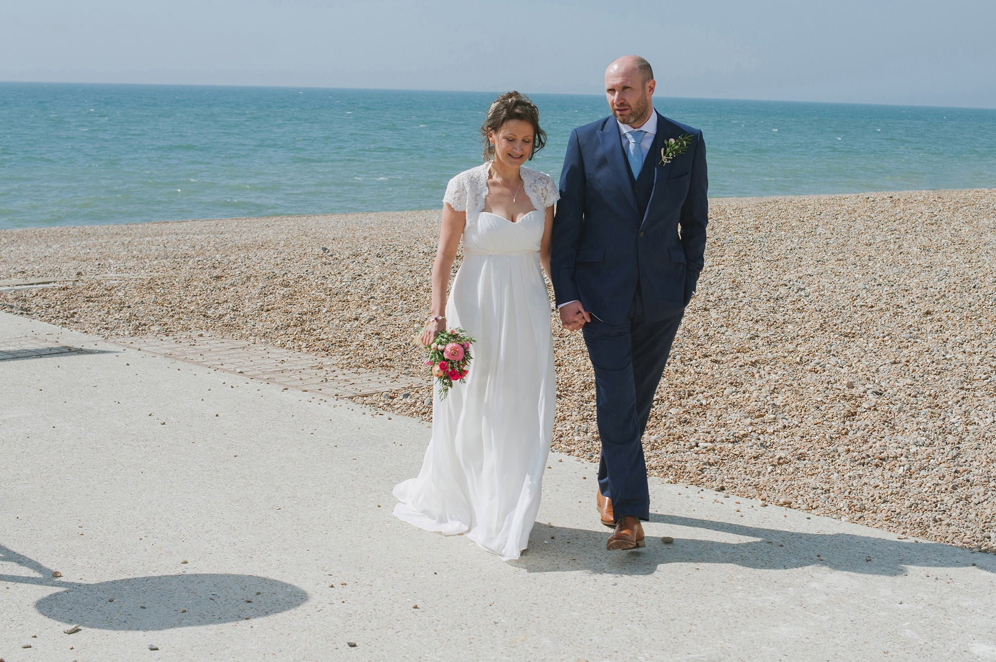 bride and groom sunny brighton beach wedding