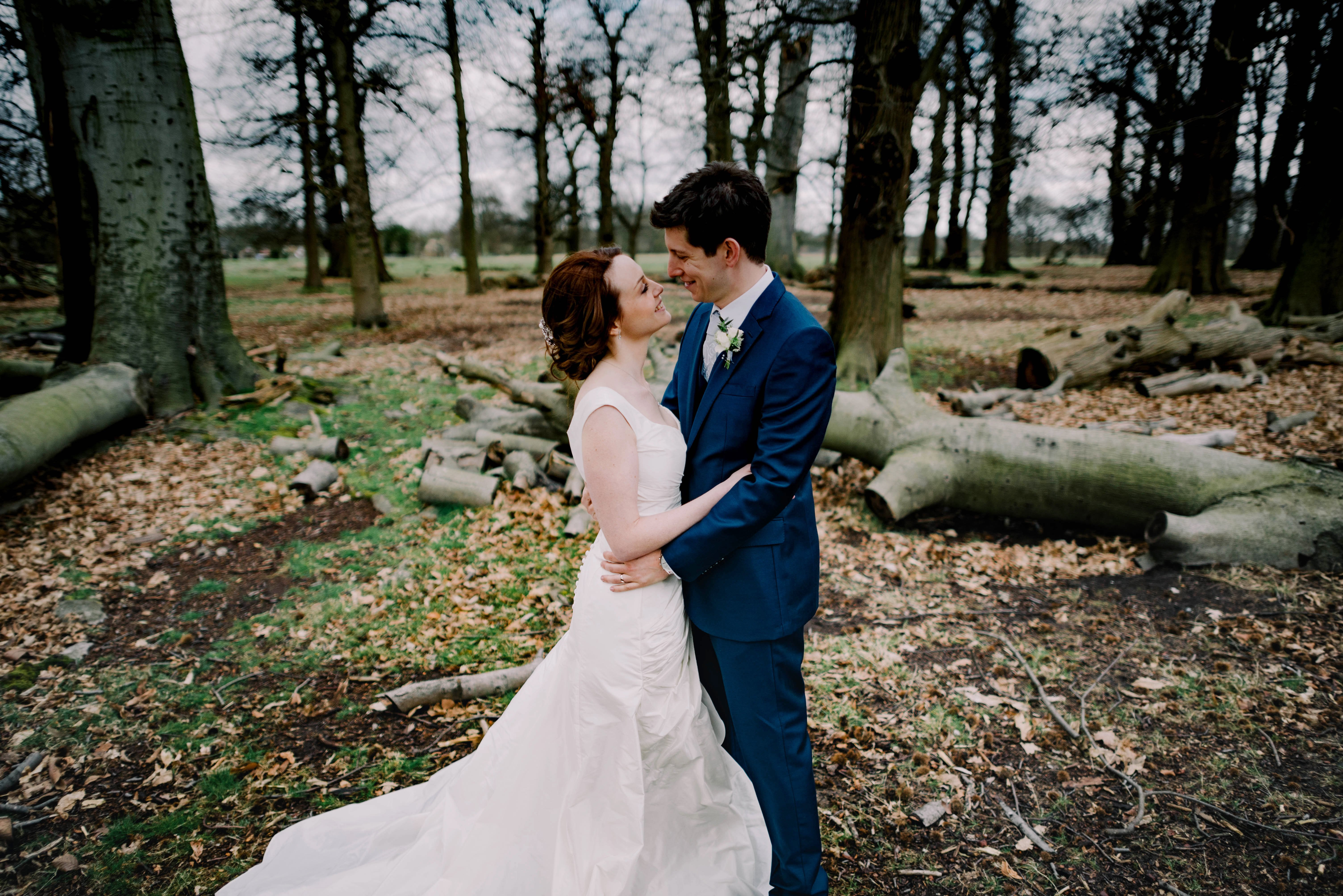 bride and groom in Richmond Park, pembrioks lodge weddings