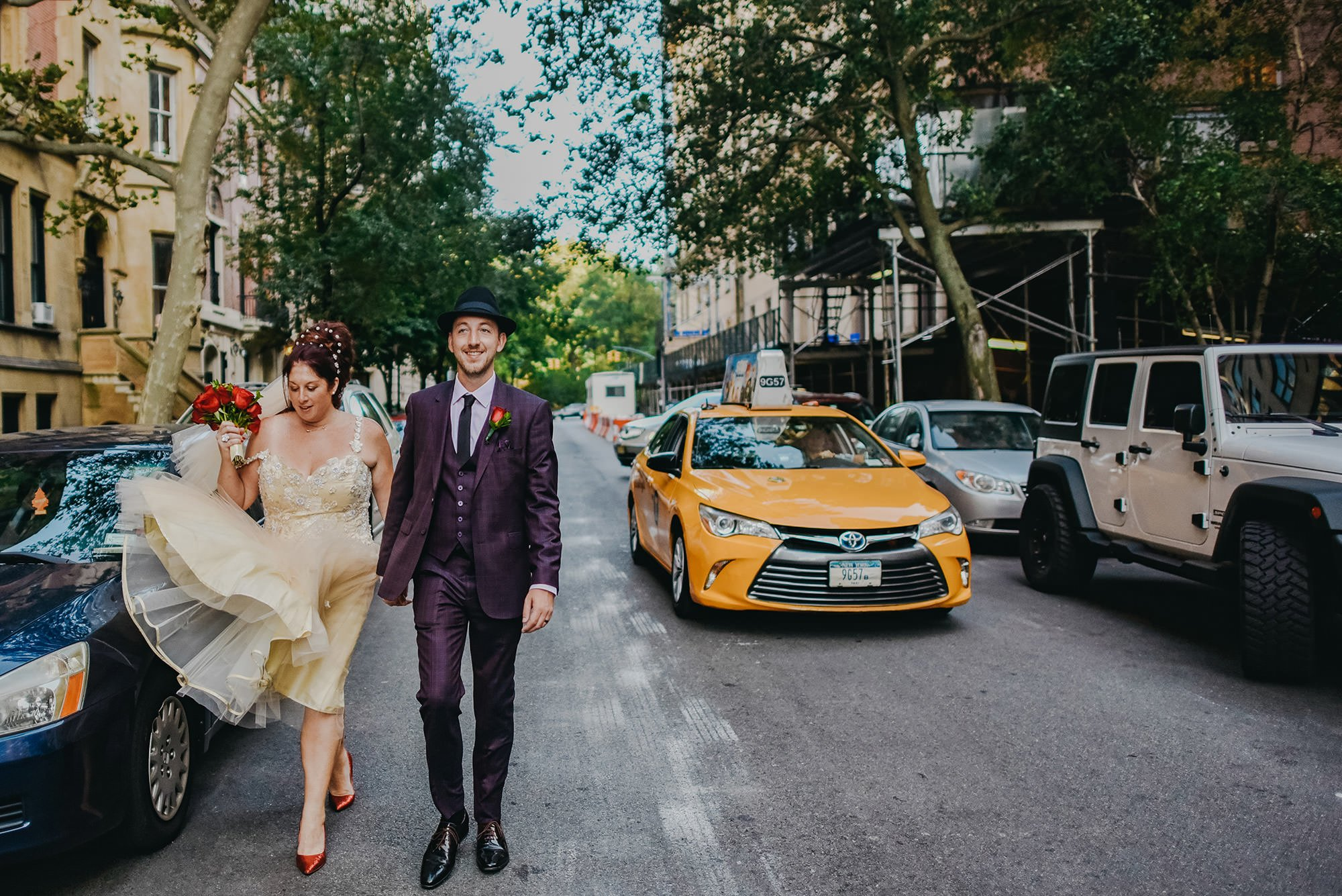 bride and groom walking on a new york with yellow cab behind them street a new york , quirky destination weddings, wedding, destination wedding new york