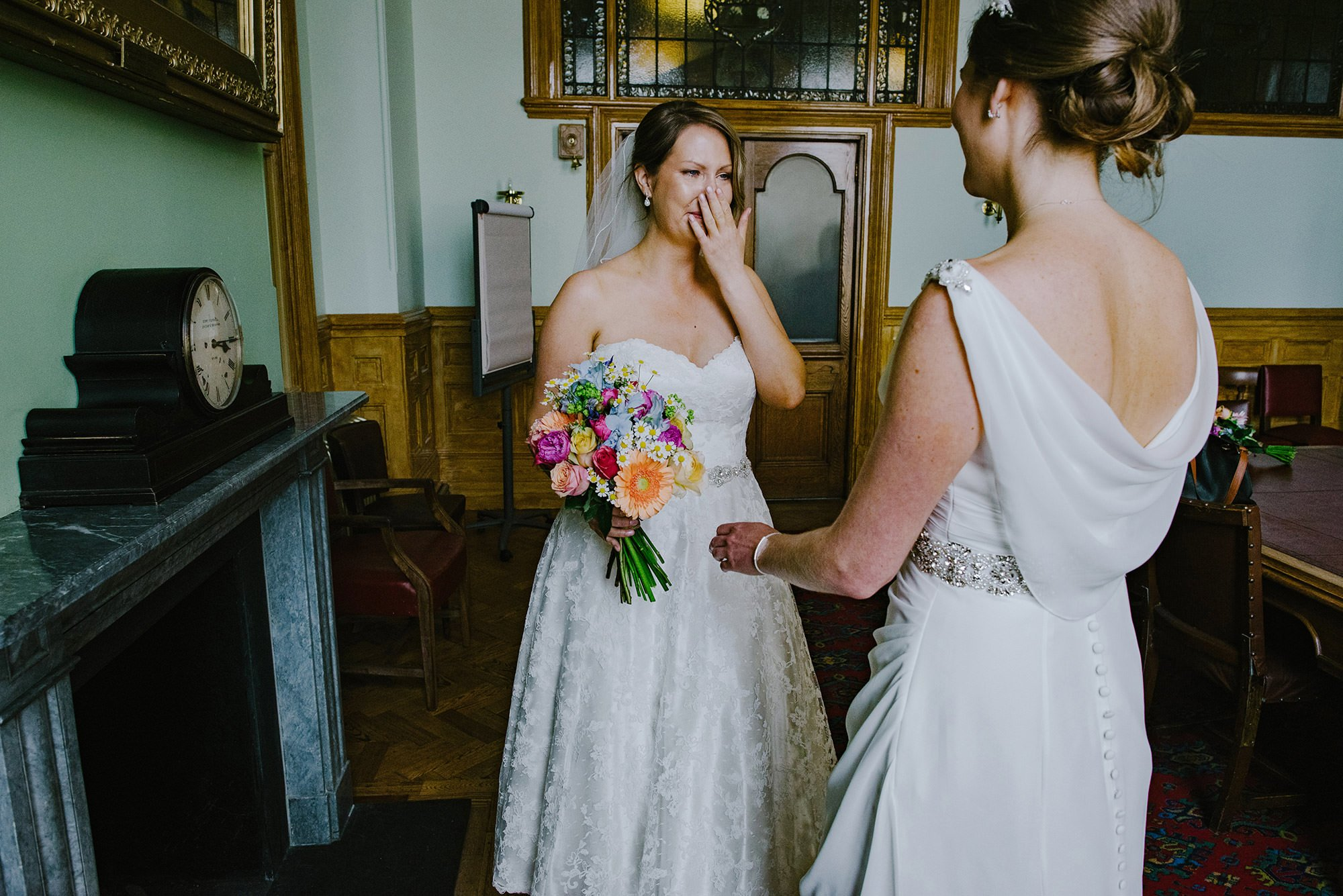 two brides seeing each other for the first time on the wedding day. brighton registry office