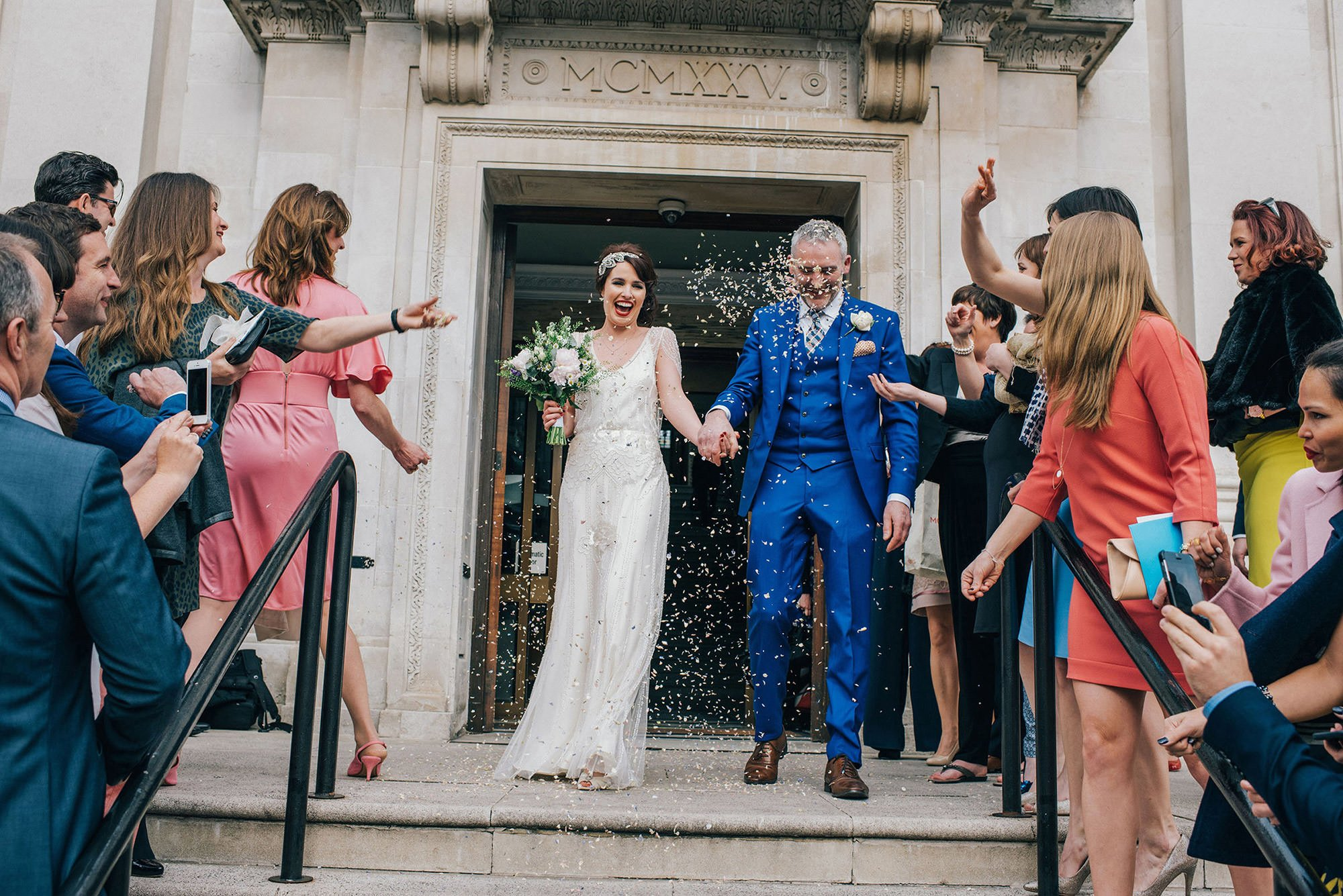 bride and groom getting married at islington town hall