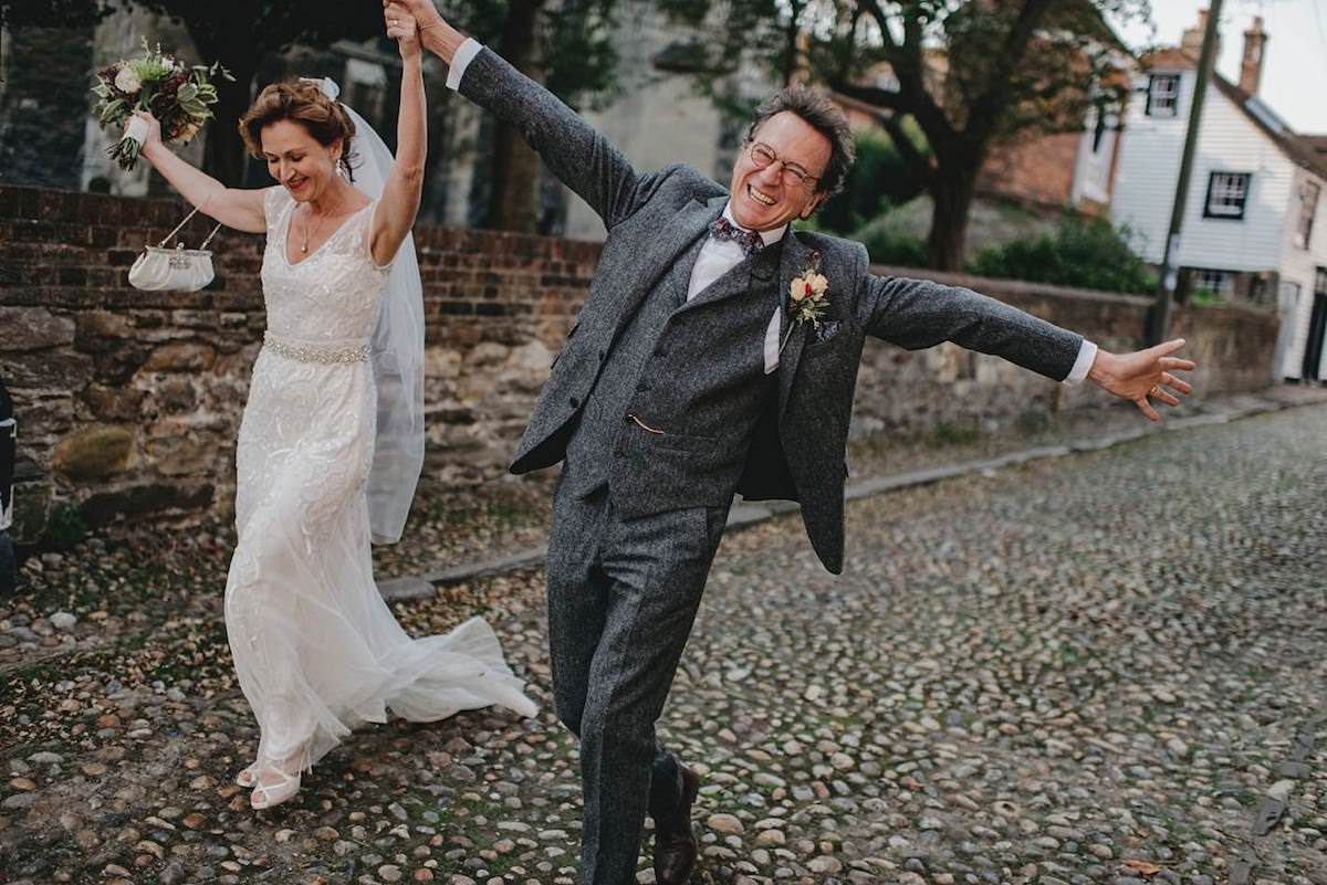 happy bride and groom dancing through the streets of Rye East Sussex