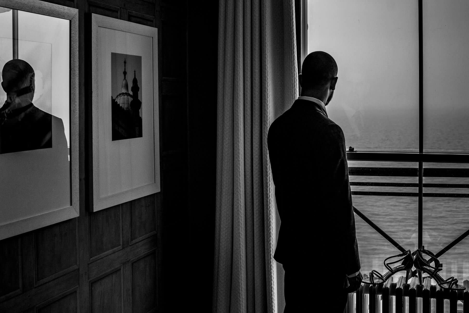 groom looking out window