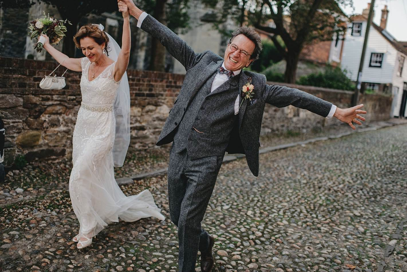 ecstatic groom and bride