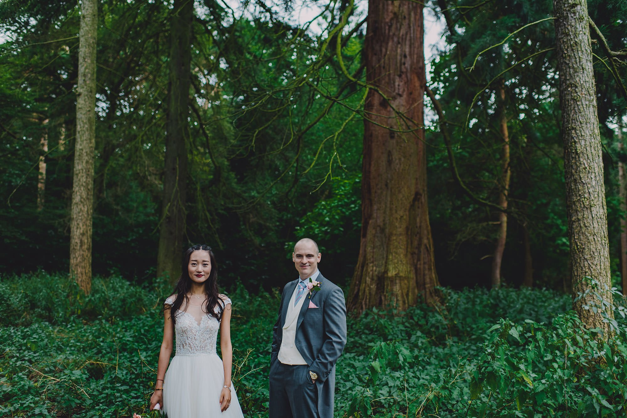 bride and groom in the woods at a wedding at nonsuch mansion
