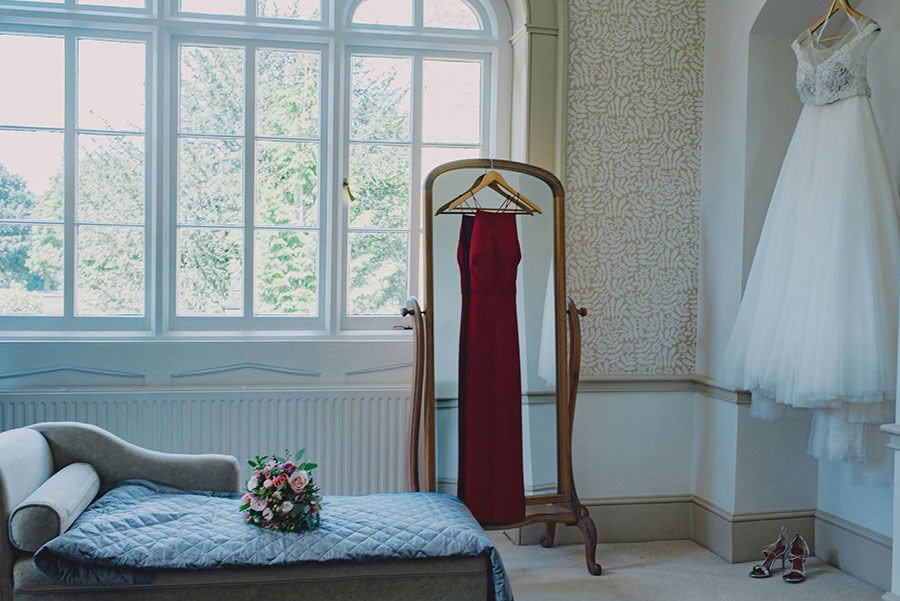 wedding and evening dress hanging in nonsuch mansion