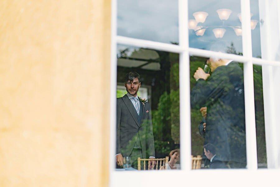 groomsman through a window