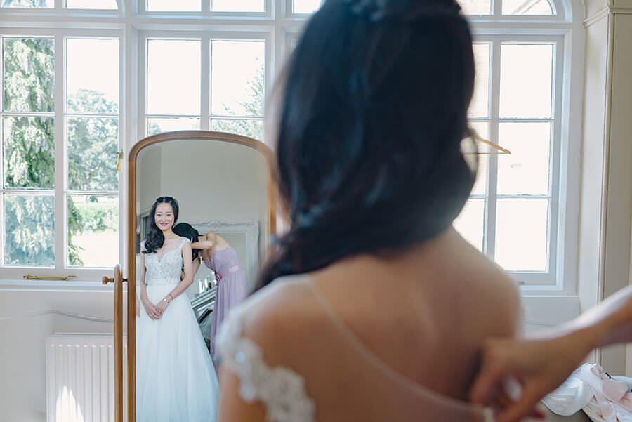 chinese bride looking in a mirror