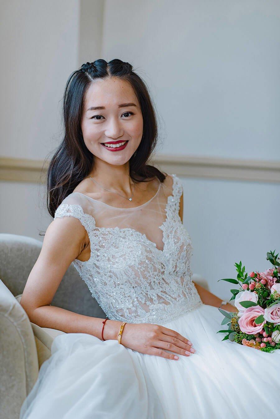 chinese bride wearing white wedding dress