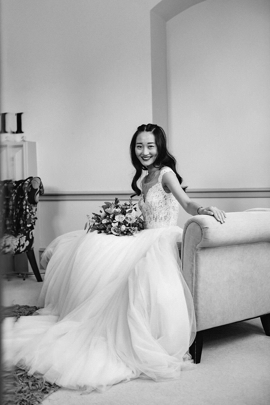 chinese bride wearing white wedding dress in black and white