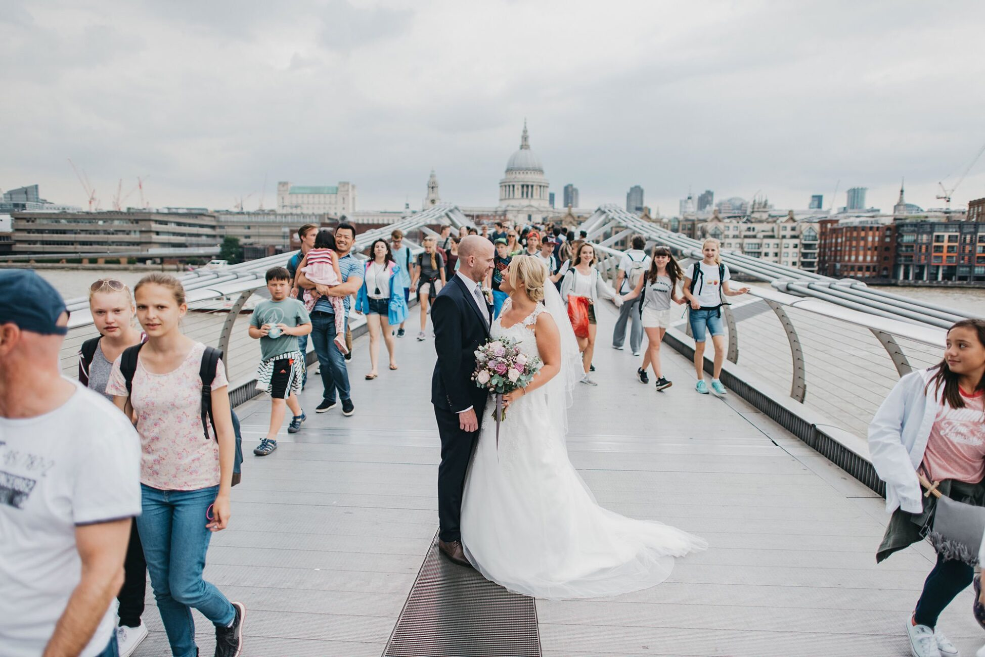 bride and groom on millennium bride london