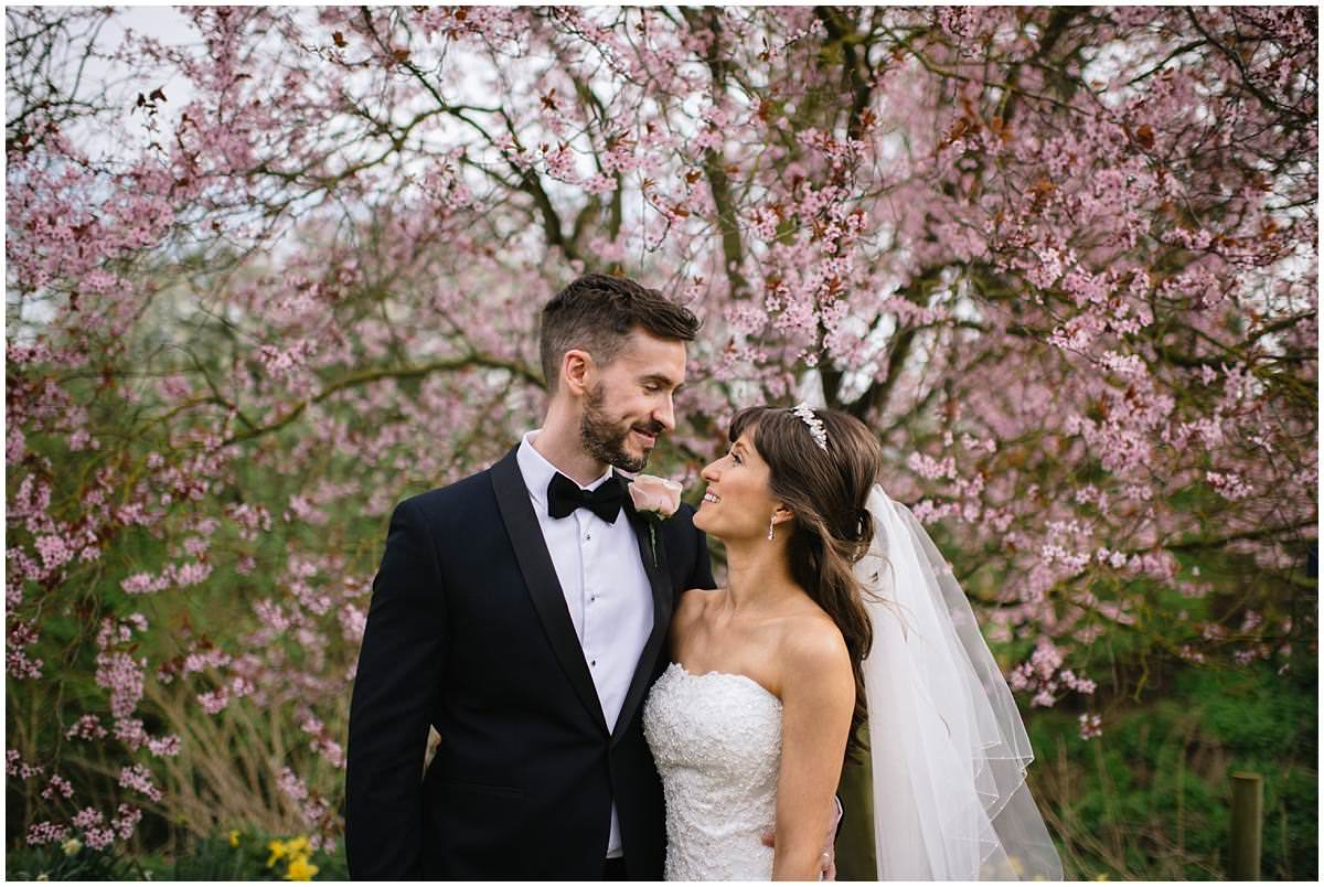 bride and groom surrounded by blouson, spring weddings, jacqui mcsweeney photography