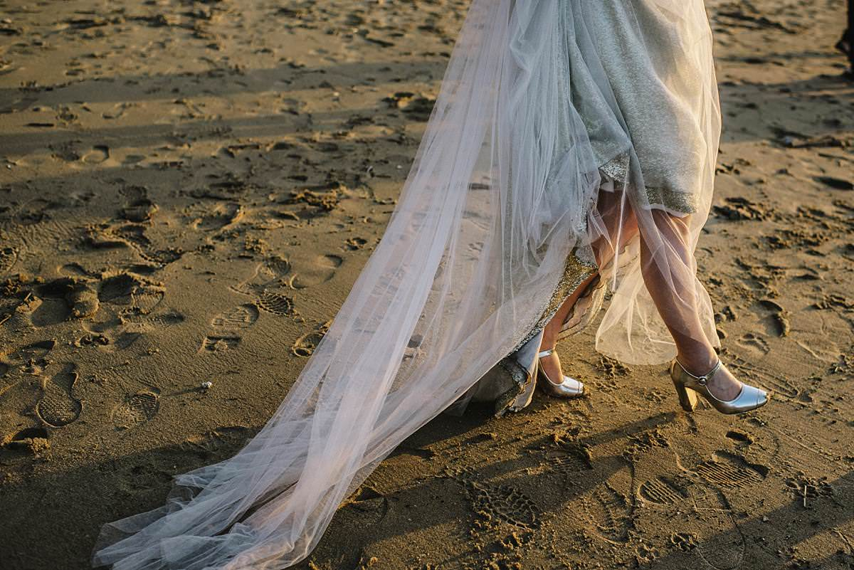detail of bride shoes on the sand, london wedding photography