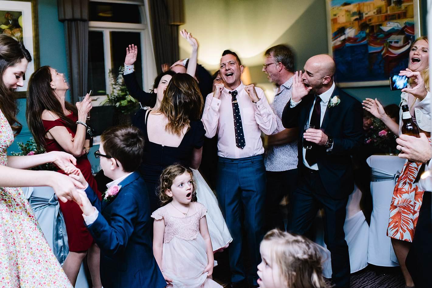 fun family wedding dancing