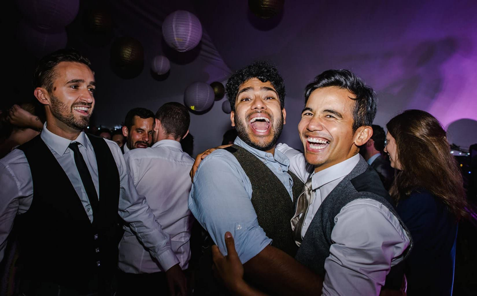 groomsmen having fun on the dance floor