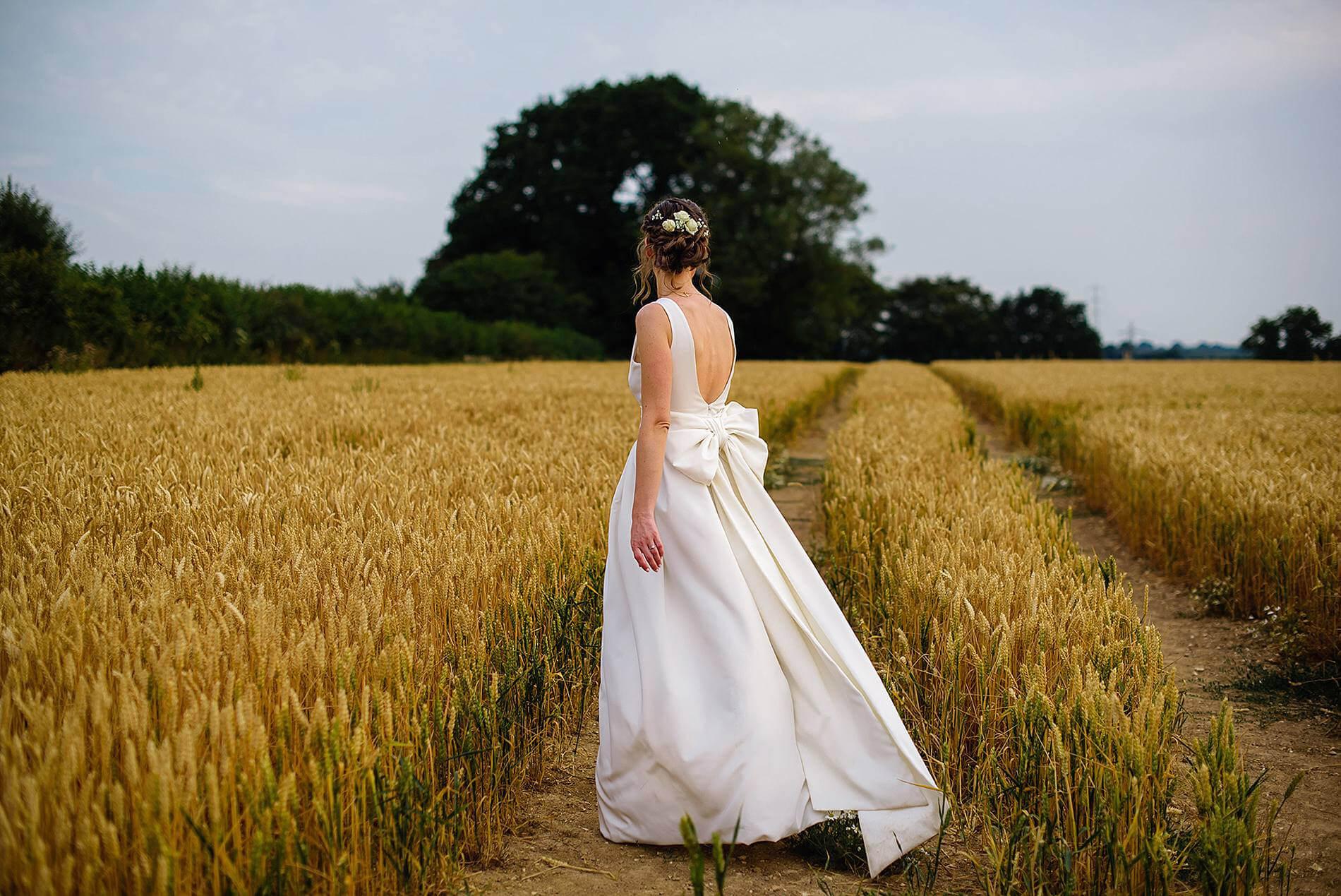 bride in hay field