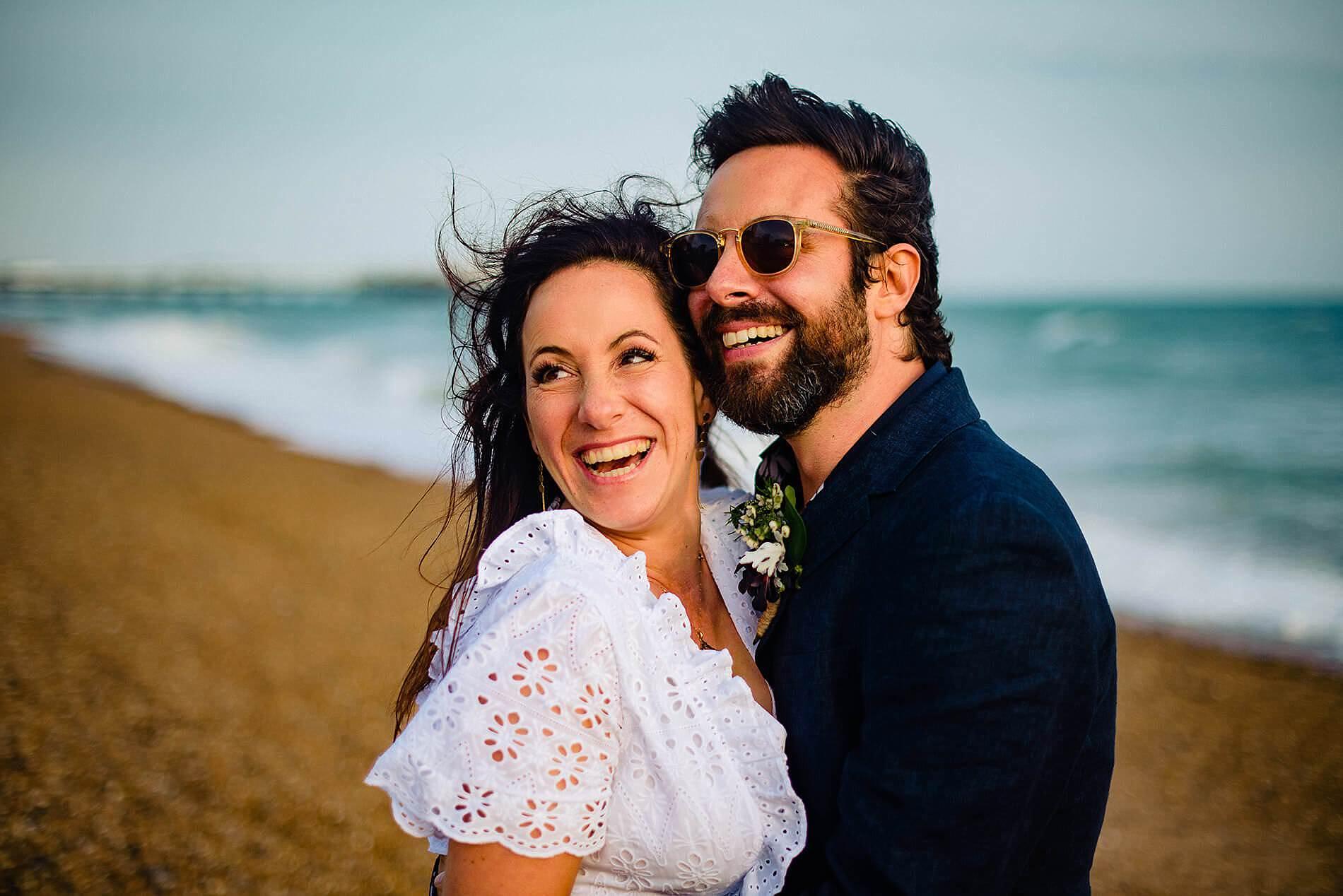 smiling bride and groom on brighton beach