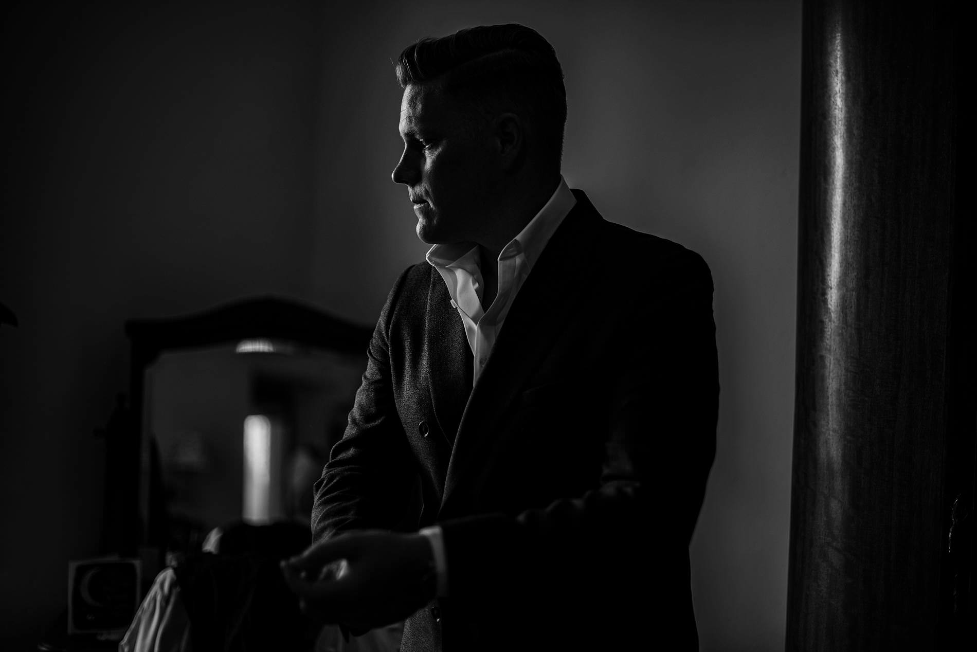 groom in window light