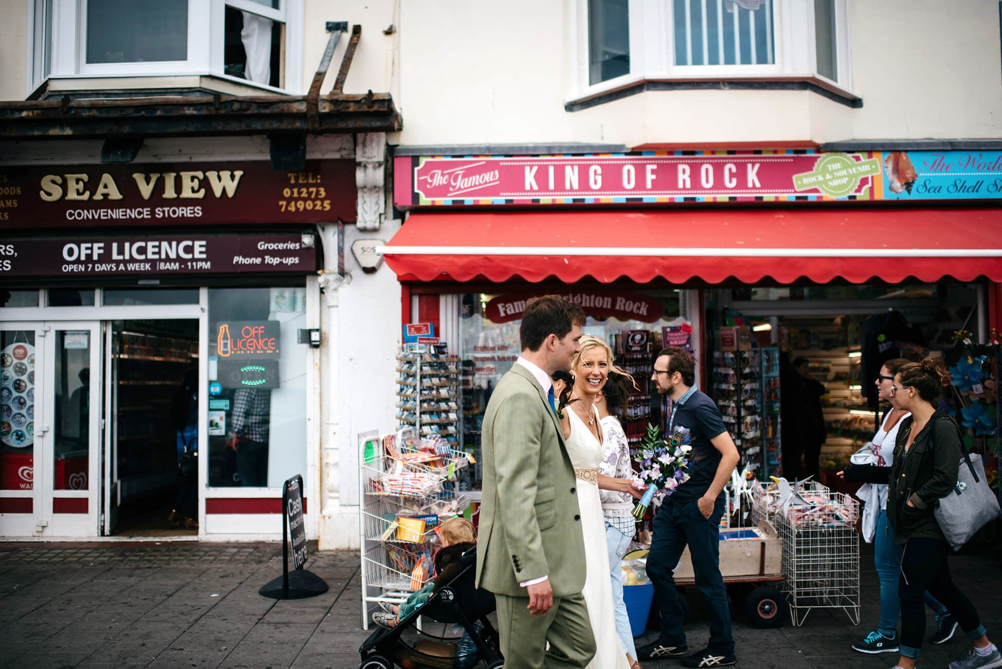 couple walking on buys street in brighton after their wedding