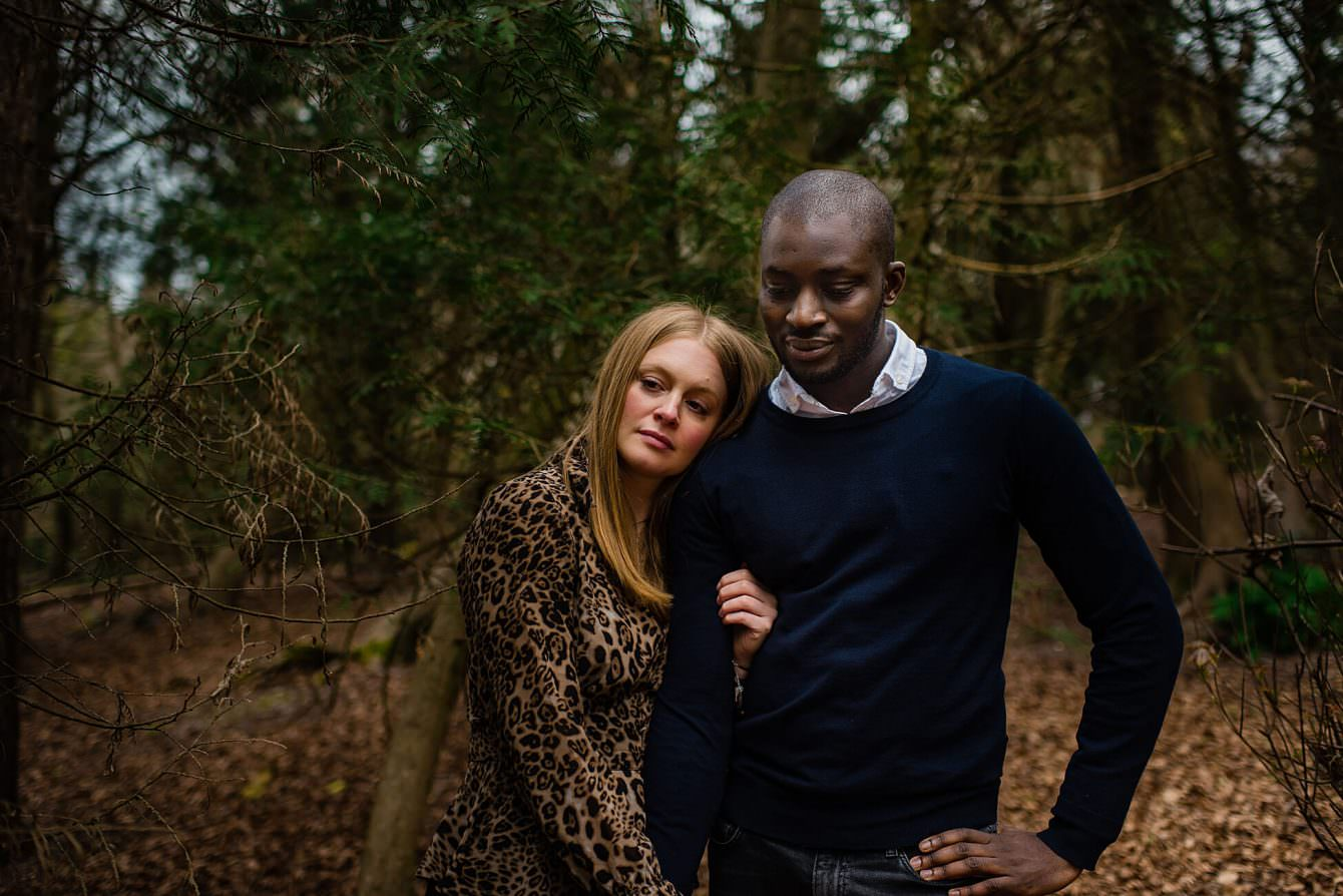 couple arm in arm in the woods