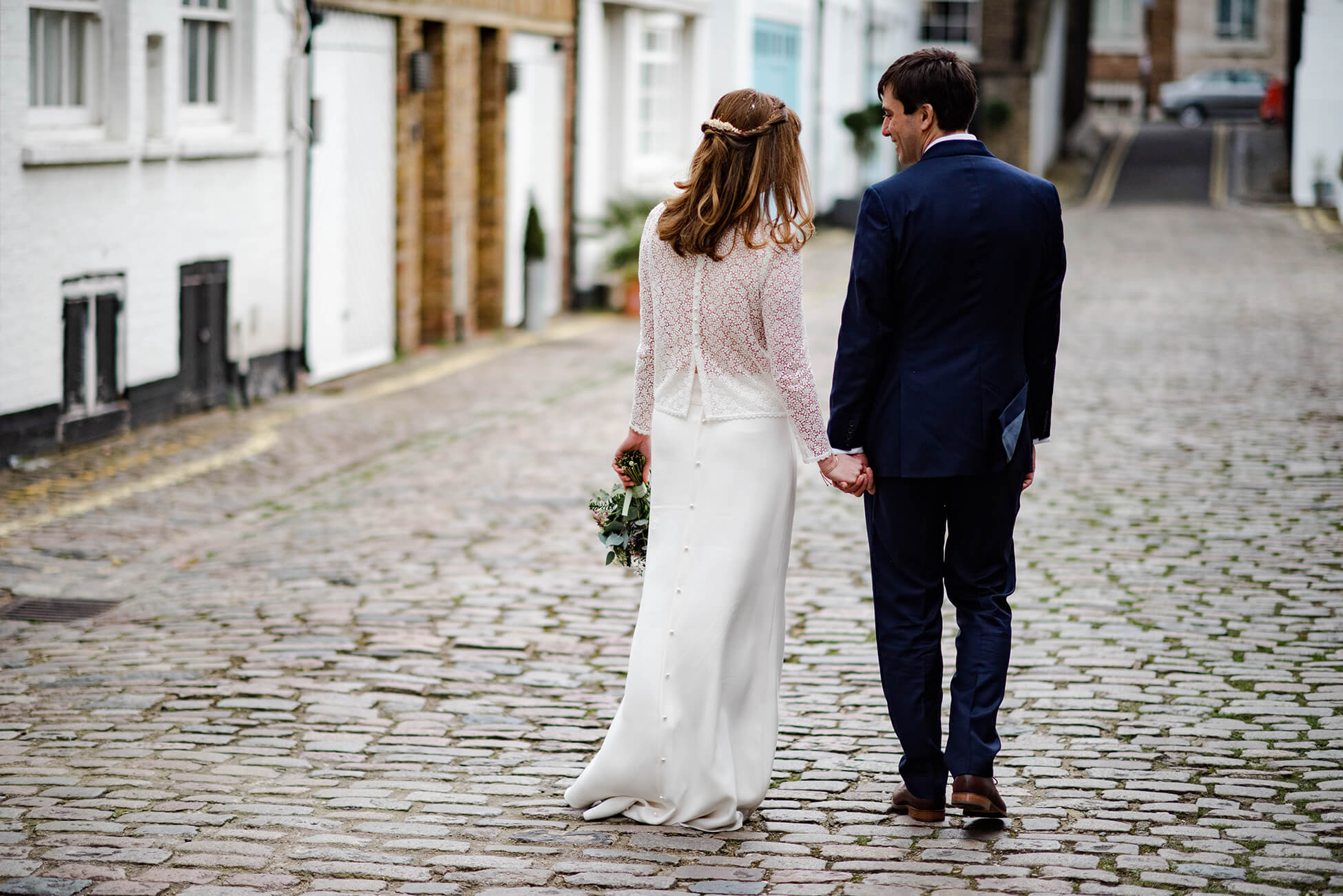 couple in cobbled mews in london