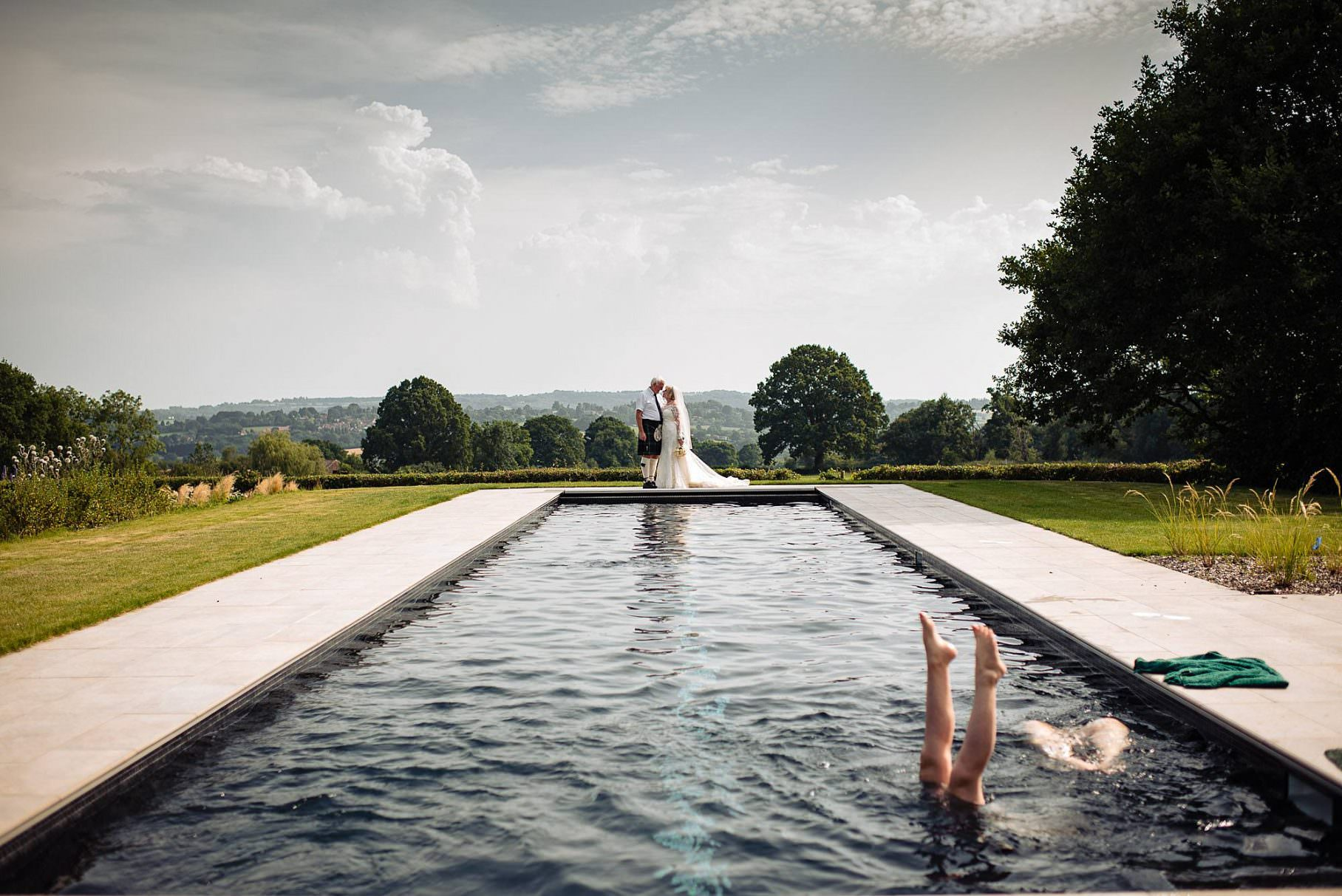 wedding portrait by swimming pool