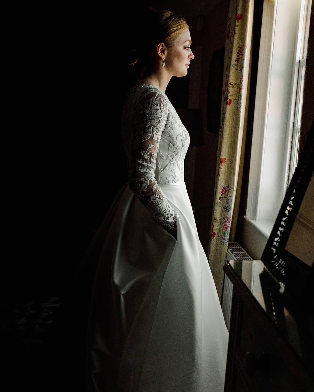 brighton bride looking out window